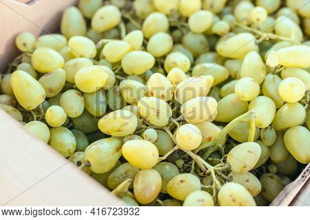 Fresh Fruit Brunch Green Grapes In Paper Boxes At The Local Market