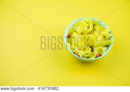 Spicy Pickled Cabbage Salad In Bowl On A Yellow Background. Traditional Spicy Side Dish Menu In Asia