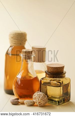 Concise Spa Composition With Oil Flasks On Beige Background.