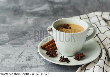 Indian Masala Chai Tea. Tea With Milk On Gray Concrete Background