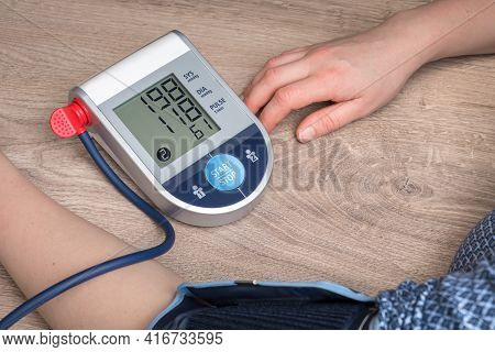 Blood Pressure Monitor With High Pressure Level On Screen - Hypertension Concept