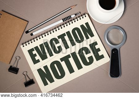 Eviction Notice. Text On White Paper On Brown Background