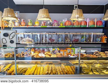 Spain, Barcelona, March, 2021: Glass Counters With Bread And Other Sweet Pastries In Modern Pastry S