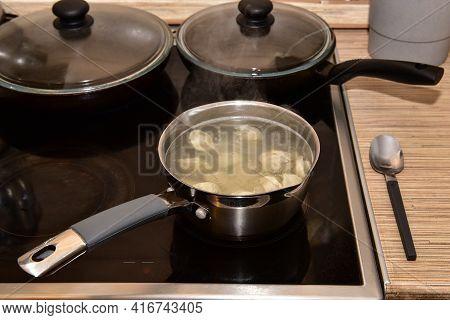 Russian Dumplings In Boiling Water. Meat Dumplings Are Boiled In A Pot Of Boiling Water.