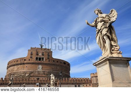 Angel Statue In Rome, Italy. Ponte Sant'angelo (saint Angel Bridge) And Castel Sant' Angelo.