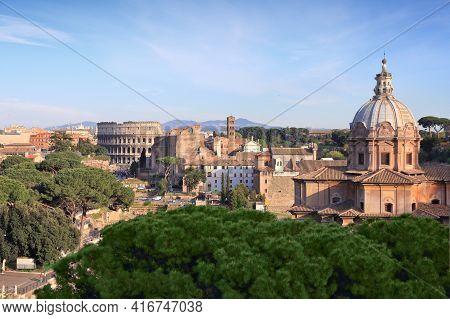 Colosseum In Rome City, Italy. Rione Monti - Cityscape With Colosseum In Monti District, Rome. Santi