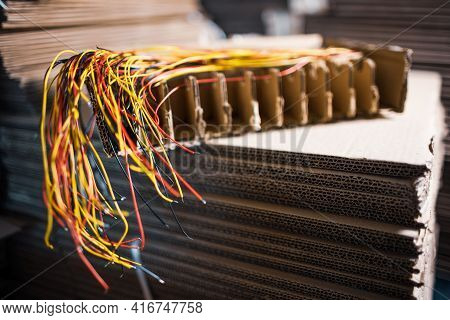 Close-up Of A Bundle Of Cut Thin Wires With Color Connections Sticking Out Of Them Against A Blurred