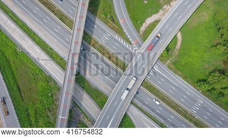 Aerial Highway Junction. Busy Highway From Aerial View, Road Traffic In City At Thailand.