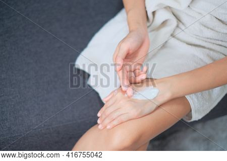 Woman Applying Natural Cream, Woman Moisturizing Her Hand With Cosmetic Cream, Spa And Manicure Conc