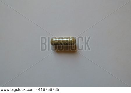 Cellulose Greenish Brown Capsule Of Iron Bisglycinate From Above