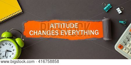 Text - Attitude Changes Everything - Appearing Behind Torn Brown Paper. Motivation Encouragement Quo