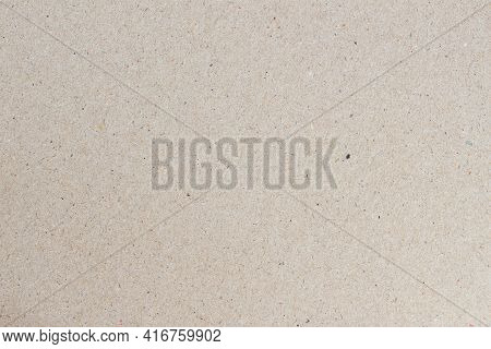 Paper Texture, Cardboard Background, Copy Space. Recyclable Material, Small Inclusions Of Cellulose