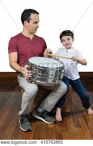 Father (44 Years Old) Teaching His Son (7 Years Old) The First Drum Lessons, Photo 2. White Backgrou
