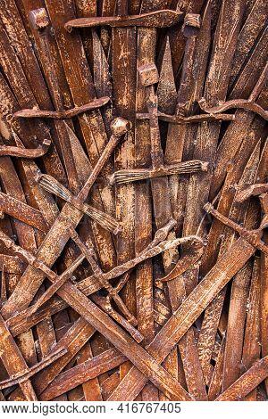 Rusty Sword, A Background Of A Large Number Of Vintage, Deformed Swords, Erosion Of Blades That Once