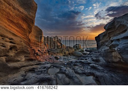 Russia. Dagestan. Dawn On The Rocky Shore Of The Caspian Sea Near The City Embankment Of Makhachkala