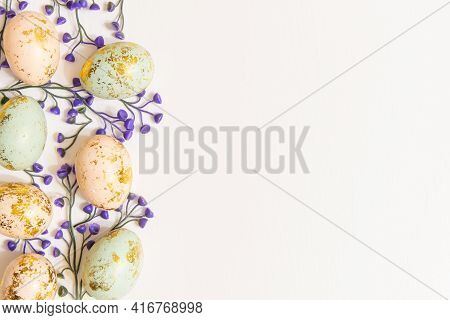 Colorful Easter Eggs With Spring Blossom Flowers Isolated On White Background And Copy Space On Righ