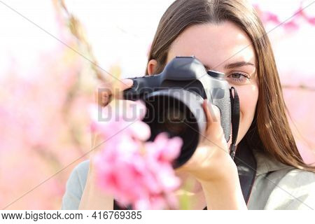 Front View Portrait Of A Photographer Photographing Flowers With Macro Lens And Dslr Camera In A Fie