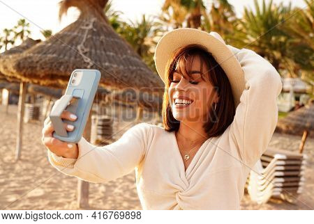 Summer Beach Vacation. Fashionable Latino Tourist Woman Taking Fun Mobile Selfie Photo With Smartpho
