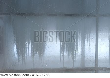 Water Inside The Cooling Tower In Winter. The Water Freezes And Ice And Icicles Form In The Cooling