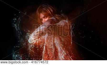 Beautiful Young Woman In A Shiny Dress Dancing In A Nightclub,