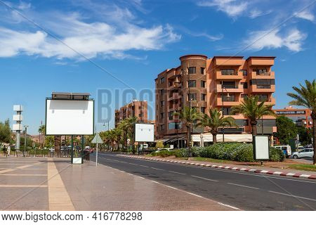 Mockup Of Blank White Billboards On Urban Street In Marrakech, Morocco. Outdoor Billboard Or Adverti