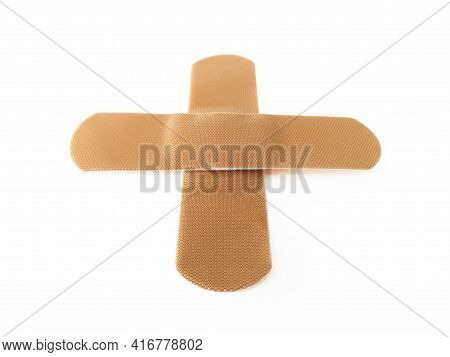 Aerial View Of Cross Bandaid Isolated On White Background. Protective Tape Strip, Wound Patch Close