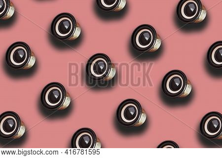 Black Audio Speaker On Pink Background. Minimal Creative Bold Colored Music Pattern. Top View Isomet
