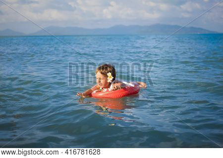 Adorable Toddler Toddler Swim In The Sea In A Special Inflatable Life Ring