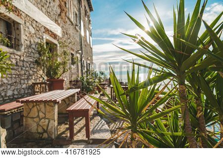 View Of Restaurant Tables At Sea Beach. Rovinj, Croatia