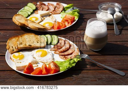 Continental Breakfast Set Of Eggs, Ham, Vegetables And Cheese. Bread And Coffee On A Wooden Table. B