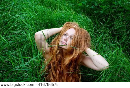Portrait Of A Beautiful Sexy Elder, Mature Redhead Content, Satisfied Woman Looking Up To The Sky, I