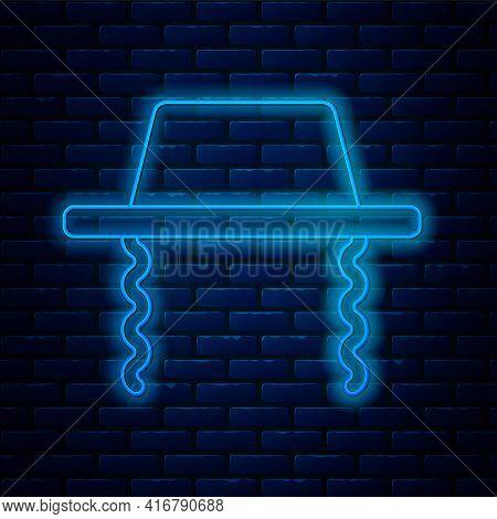 Glowing Neon Line Orthodox Jewish Hat With Sidelocks Icon Isolated On Brick Wall Background. Jewish