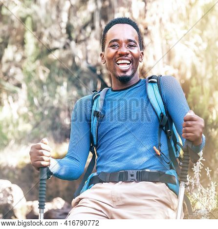 Portrait Of A Cheerfully Laughing African-american Ethnicity Young Man Sitting With A Backpack And T