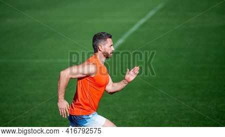 Sporty Runner. Stamina. Sport And Endurance. Outdoor Stadium Sprint. Physical Training.
