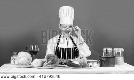The Best Recipe. Cooking Concept. Working In A Modern Kitchen. Woman Chef Read Cookbook. Can Be Used