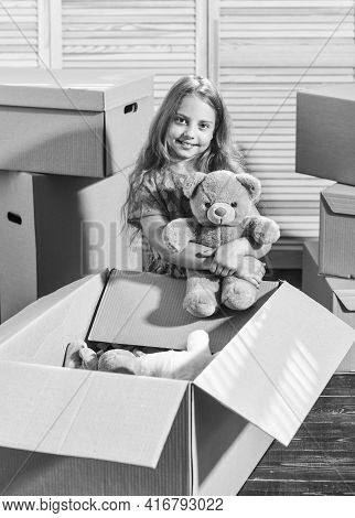 Moving Routine. Only True Friend. Girl Child Play With Toy Near Boxes. Packaging Things. Move Out Co