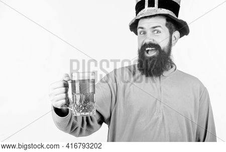 Celebrating Saint Patricks Day. Bearded Man Toasting To Saint Patricks Day. Hipster In Leprechaun Ha