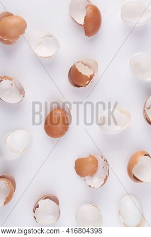 Top View Vertical Shot Empty White And Brown Eggshells.