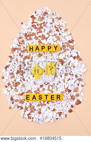 Eggshell Pieces With Cartoon Chiks On Beige Background.