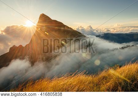Mountain Landscape With Flowing Fog And Clouds At Sunrise. Kolukkumalai Tea Estate Point In Munnar.
