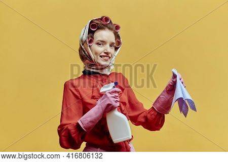 Happy Cleaning Lady Wearing Hair Curlers And A Headscarf. Pin-up Style.