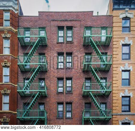 New York City, Usa, May 2019, View Of A Red Brick Building With Fire Escape In The West Village Neig