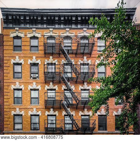 New York City, Usa, May 2019, View Of An Orange Brick Building With Fire Escape In The West Village