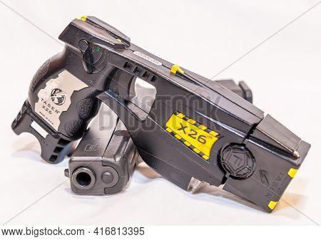 Pittsburgh, Pennsylvania, Usa April 13, 2021 A Black Glock 9mm Pistol With A X26 Taser Gun, Both Use