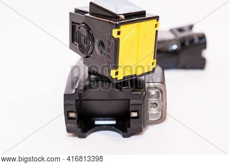 Pittsburgh, Pennsylvania, Usa April 13, 2021 A X26 Taser With An Unloaded Yellow Cartridge Laying On