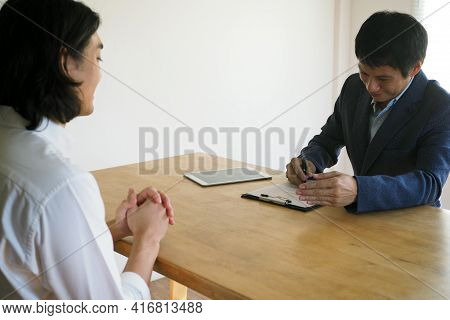 Benevolent Executives Are Interviewing Candidates. Friendly Interviews Focus On Candidate Skills And