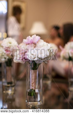 Glass Vases With White Roses And Pink Flower Prepared For A Wedding Ceremony