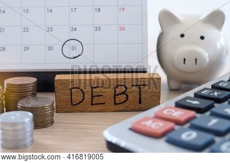 Concept Of Debt: By Throwing A Clean White Calendar, Specify Debt, Expenses That Will Arrive On The