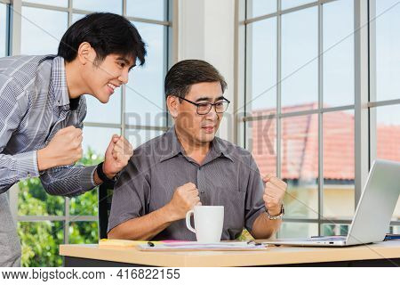Asian Senior And Young Business Man People Excited Celebrating Corporate Victory Together In Office.