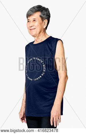 Senior Asian man in navy tank top with back to basic quote men' apparel